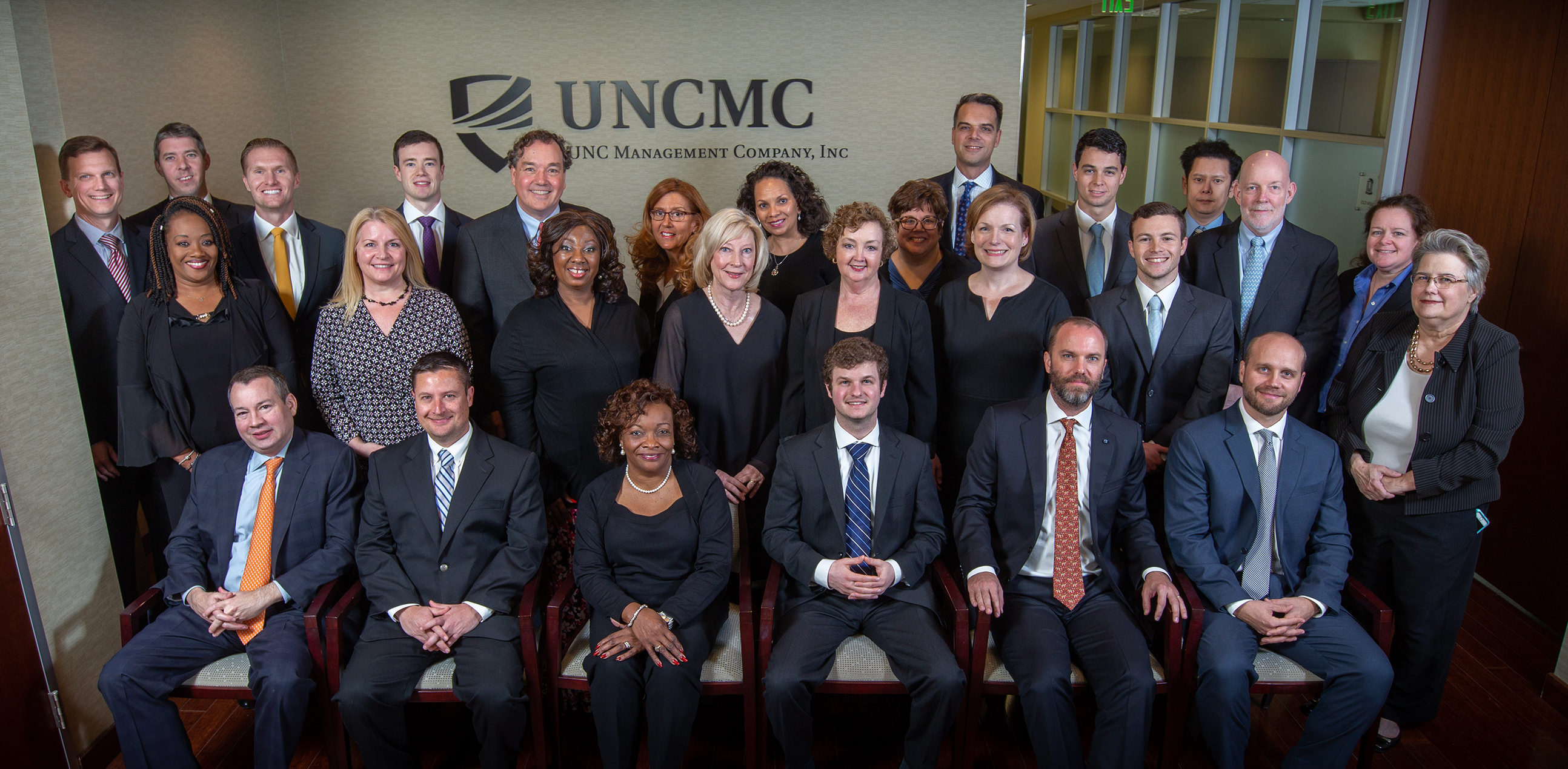 UNCMC staff posing as a group in office lobby